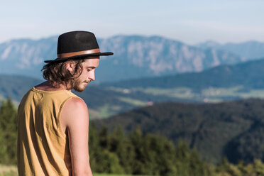 Austria, Mondsee, Mondseeberg, young man wearing a hat - WVF00835