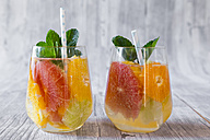 Two glasses of detox water infused with citrus fruits - SARF03183