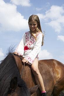 Smiling girl sitting on horseback - FSF00778