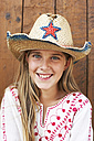 Portrait of smiling girl wearing straw hat - FSF00793