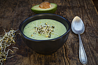 Bowl of avocado cucumber soup garnished with sprouts - LVF05864