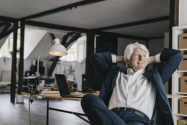 Senior businessman relaxing in his office - KNSF01018
