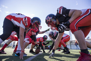 American football players on the line of scrimmage during a match - ABZF01901