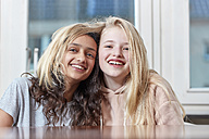 Portrait of two happy girls playing with their hair - RHF01826