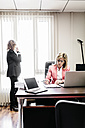 Two businesswomen in office - JRFF01196