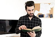 Young man reading book - FMOF00176