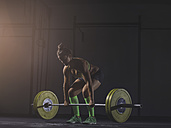 Young woman lifting barbell - MADF01333