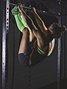 Young woman exercising at power rack - MADF01339