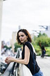 USA, New York City, portrait of  woman on High Line Park in Manhattan - GIOF01872