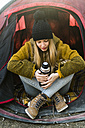 Young woman in tent - KKAF00409