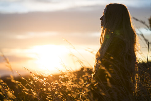 Young woman in nature at sunset - KKAF00439