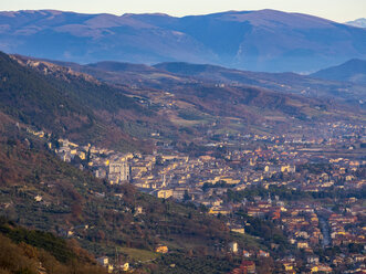 Italy, Umbria, Gubbio, aerial view of the town at sunset - LOMF00511
