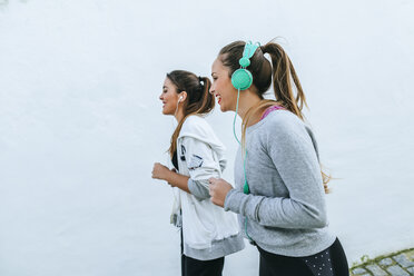 Young women jogging in the street - KIJF01229