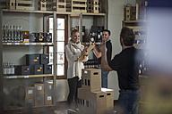 Confident staff in wine shop - ZEF12866
