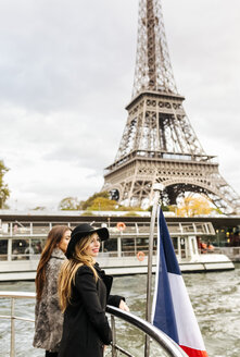 Paris, France, two tourists taking a cruise on Seine River with Eiffel Tower in the background - MGOF02980