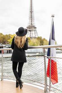 Paris, France, back view of tourist taking a cruise on Seine River looking at Eiffel Tower - MGOF02983