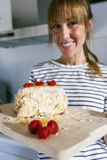 Young woman presenting vegan cake - VABF01192