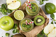 Two glasses of green smoothie and ingredients - JUNF00862