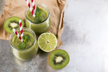 Two glasses of green smoothie and ingredients - JUNF00865
