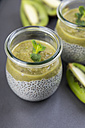 Glass of chia pudding with soya vanilla milk and kiwi mush - JUNF00877