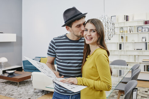 Couple with floor plan choosing furniture in furniture shop - RORF00610