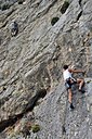 Greece, Kalymnos, two climbers in rock wall - LMF00665