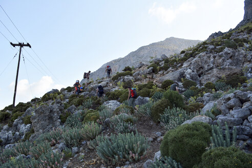 Greece, Kalymnos, climbers walking  towards rock - LM00668
