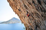 Greece, Kalymnos, two climbers in rock wall - LMF00674