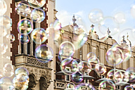 Poland, Krakow, Old Town, Main Square, cloth hall and soap bubbles - CSTF01235
