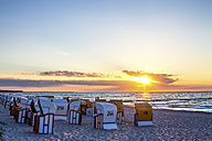 Germany, Zingst, hooded beach chairs at dawn - PUF00590