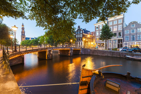 Netherlands, Amsterdam, lighted bridge over Prinsengracht in the evening - WDF03917