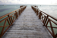 Caribbean, Dominican Republic, jetty at Bavaro Beach at sunrise - DSGF01460
