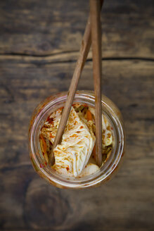 Glass of Kimchi and chopsticks - LVF05888