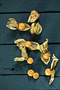 Whole and sliced physalis on coloured wood - MAEF12149