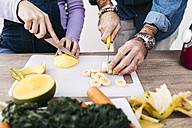 Hands of couple chopping fruits for preparing smoothies - JRFF01238