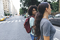 USA, New York City, two friends crossing the street - GIOF01969