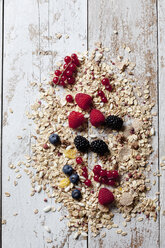 Granola with various wild berries on wood - CSF27921
