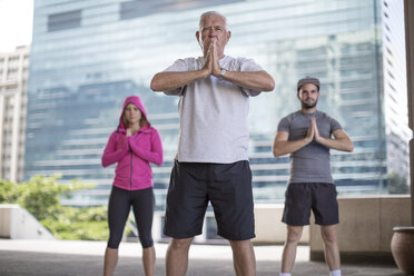 Three athletes exercising in the city - ZEF12947