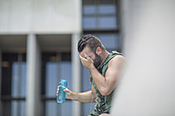 Athlete taking a water break in the city - ZEF12950