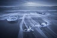 Iceland, Jokulsarlon, glacial ice on the beach at blue hour - EPF00360