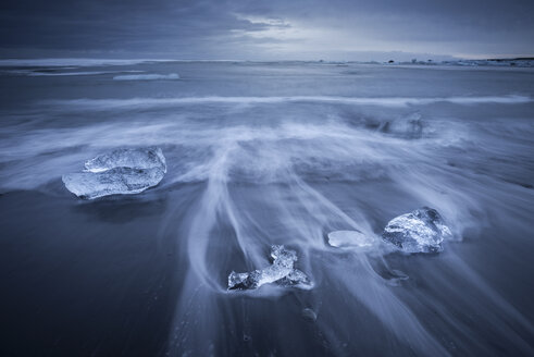 Iceland, Jokulsarlon, glacial ice on the beach at blue hour - EPF00360