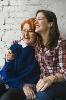 Happy adult daughter embracing mother - ZEDF00522