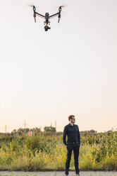 Drone flying above businessman - KNSF01129