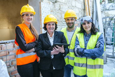 Portrait of three women and a man on construction site - KIJF01287