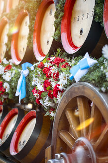 Germany, Bavaria, Munich, wooden barrels on cart at Oktoberfest - MMAF00051