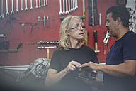 Two mechanics discussing in workshop - ZEF13012