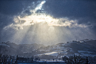 Italy, Umbria, Apennines, ray of light after a storm - LOMF00529