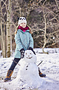 Portrait of smiling girl with a snowman - XCF00141