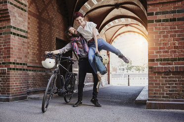 Happy couple with electric bicycle - RORF00653