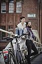 Germany, Hamburg, electric bicycle leaning against railing on a bridge - RORF00656